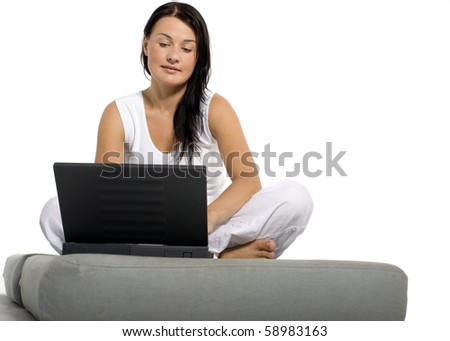 Beautiful girl working on laptop at home - stock photo