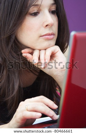 beautiful girl working with laptop computer - stock photo
