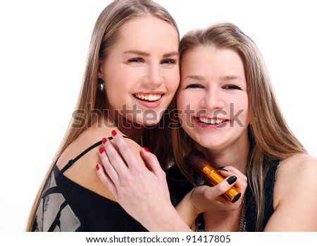 Beautiful girlfriends over white background