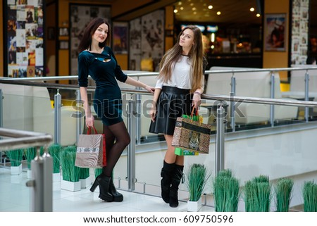Beautiful Girls Are Shopping At The Mall