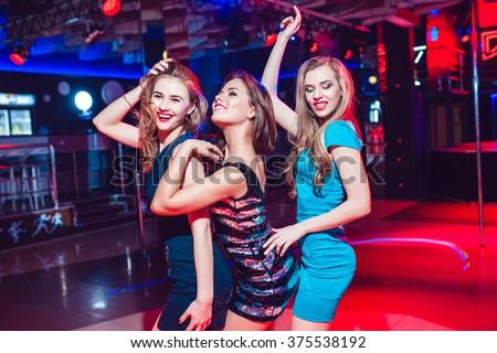 Beautiful girls having fun at a party in nightclub - stock photo
