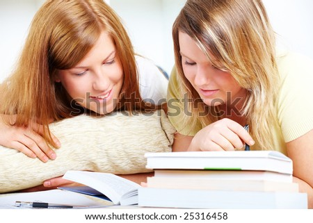 Beautiful girls learning; reading from books