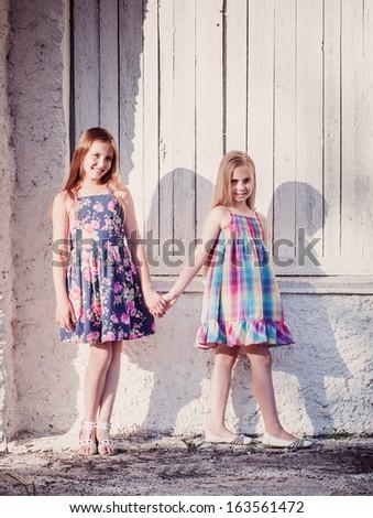 beautiful girls on background white wall  - stock photo
