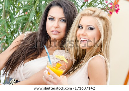 beautiful girls spending time and having fun on a sunny day - stock photo