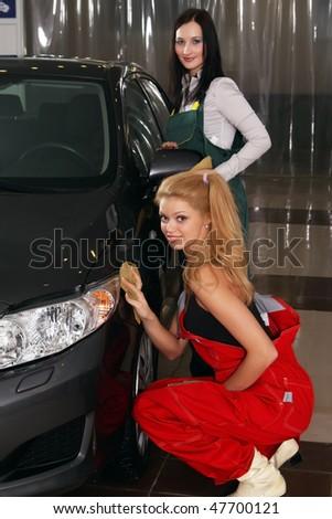 beautiful girls wash cars - stock photo