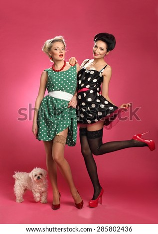 beautiful girsl with a dog , vivid emotions, hairstyle and makeup style pin-pack, a good figures - stock photo