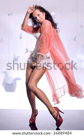 Beautiful glamour girl with a long voile - stock photo