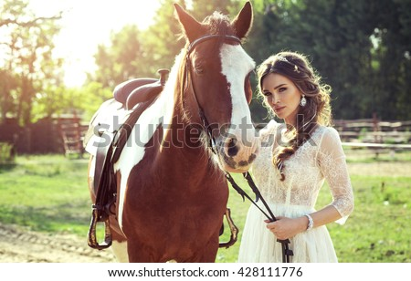 Beautiful glamour woman with a horse - stock photo