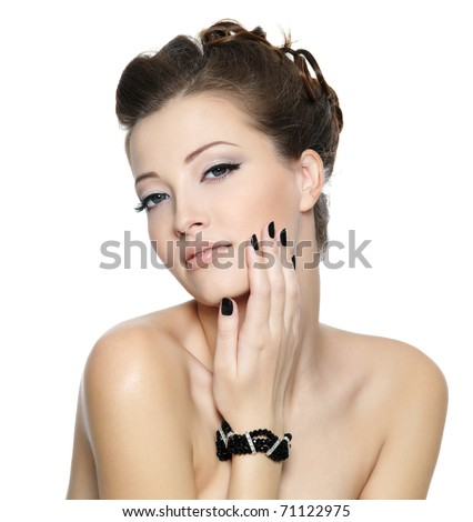 Beautiful glamour young woman with black nails and stylish hairstyle posing on white background - stock photo