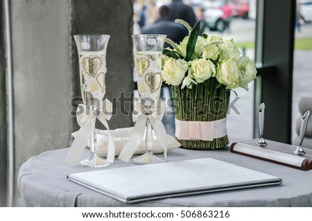 Beautiful glasses with a white sparkling wine on the table