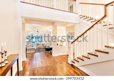 Beautiful glossy wooden stairs with two burning flamed candle in a luxury house