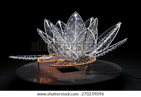 Beautiful glowing flower sculpture photographed close up - stock photo