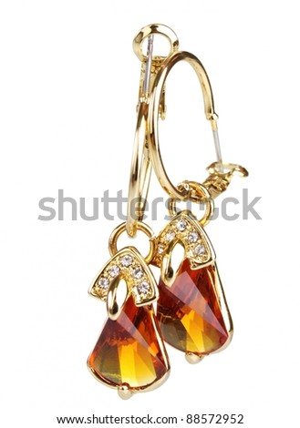 beautiful gold earrings with precious stones isolated on white - stock photo