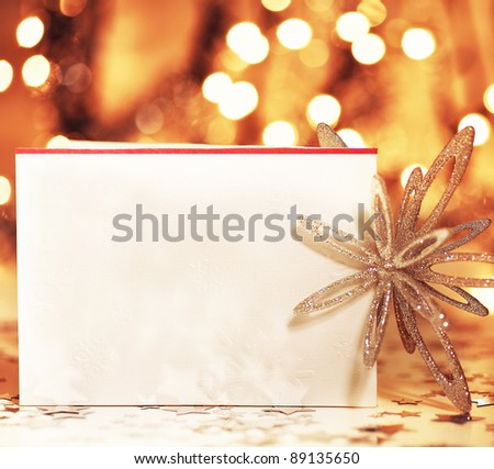 Beautiful gold happy Christmas card,winter holiday background, decoration postcard with snowflakes abstract over defocused lights - stock photo