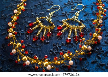 beautiful gold ornaments for the hair on a dark background. gold jewelry for women. necklace and earrings