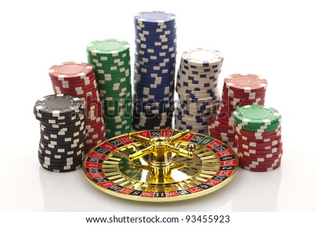 Beautiful gold roulette with casino chips on a white background. - stock photo