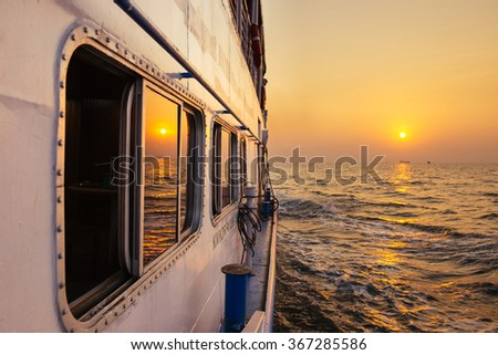 Beautiful gold sunset from ferry boat in open sea