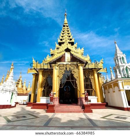 Beautiful gold temple pavilion encircling the main pagoda of Shwedagon, Yangon, Myanmar, 29th January 2010. - stock photo