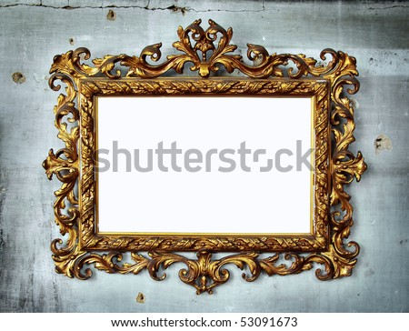 Beautiful golden baroque frame hanged in an old wall with holes and cracks - stock photo
