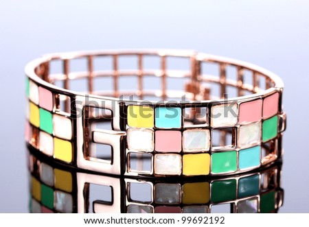 Beautiful golden bracelet on grey background - stock photo