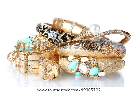 Beautiful golden bracelets and rings isolated on white - stock photo