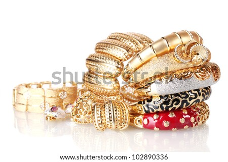 Beautiful golden bracelets isolated on white - stock photo