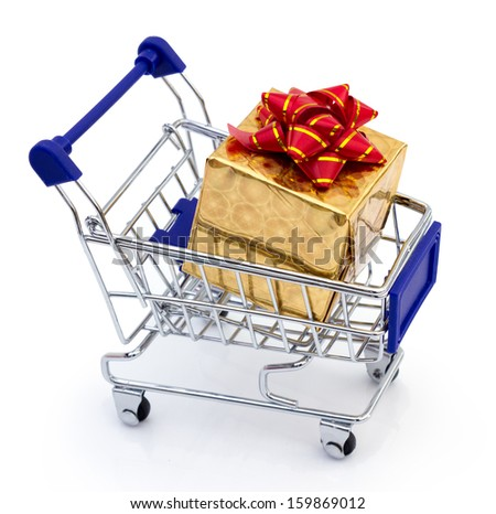 beautiful golden gift with red ribbon in shopping cart