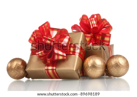 beautiful golden gifts with red ribbon and Christmas balls isolated on white - stock photo