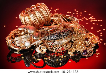 Beautiful golden jewelry on red background