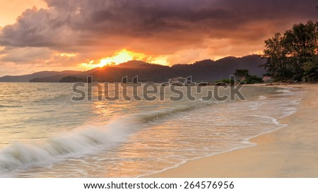 Beautiful golden sunset in the seaside with clean beach - stock photo