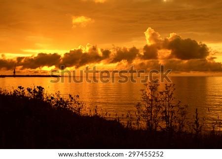 Beautiful golden sunset over sea - stock photo
