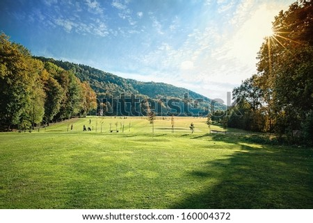 Beautiful golf course in against the light - stock photo