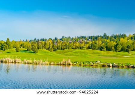 Beautiful golf place with gorgeous green, pond in winter