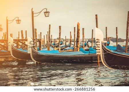 beautiful gondolas in a canal in Venice, Italy - stock photo