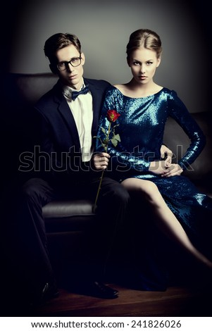 Beautiful gorgeous couple in elegant evening dresses. Fashion, glamour. - stock photo
