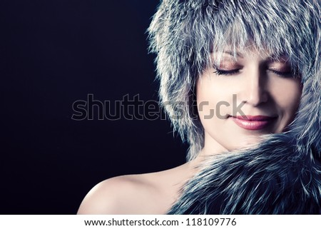 beautiful gorgeous woman portrait in fur, vintage portrait of mid adult attractive smiling lady with copyspace, over black background