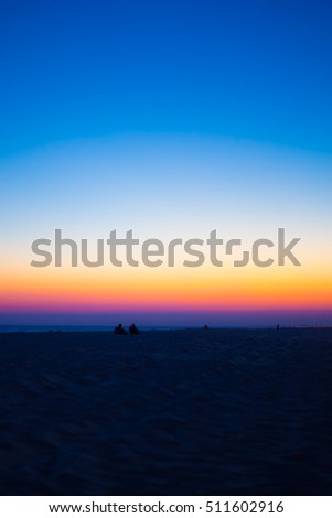 Beautiful Gradient colorful sunset sky  over beach