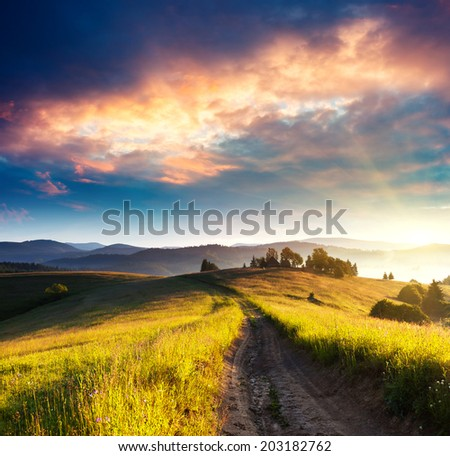 Beautiful green hills at dusk. Dramatic overcast sky. Carpathian, Ukraine, Europe. Beauty world. - stock photo