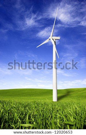Beautiful green meadow with Wind turbines generating electricity - stock photo