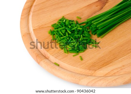 beautiful green onion chives on wooden board isolated on white