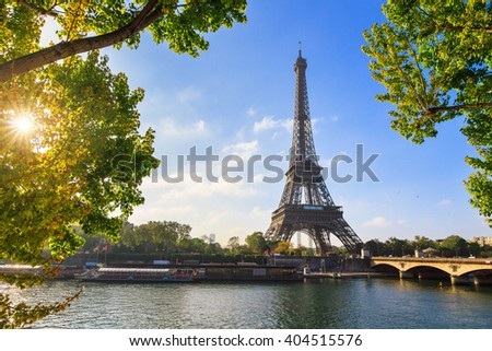 Beautiful green spring leafs at the Eiffel tower in Paris, France - stock photo