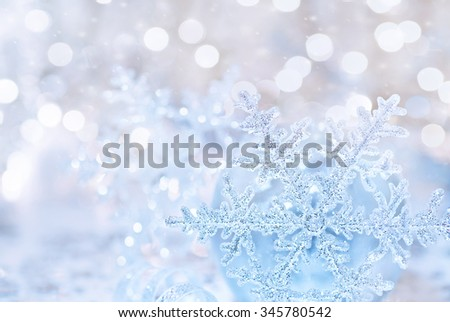 Beautiful greeting card for Xmas holidays, abstract festive background, silver shiny snowflake over blurry backdrop, stylish Christmas tree decoration - stock photo