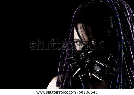 Beautiful Grunge Girl with Spiked Gas mask and Dreadlocks.