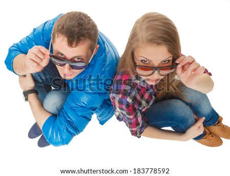 beautiful guy and girl in sunglasses on white background