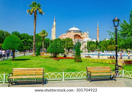 Beautiful Hagia Sophia with garden full of colorful flowers, benches. Hagia Sophia was Christian patriarchal basilica, imperial mosque and now a museum, Istanbul, Turkey - stock photo