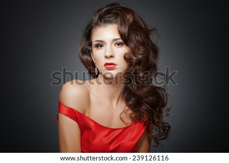 Beautiful hair, vintage portrait of an young girl in red dress - stock photo