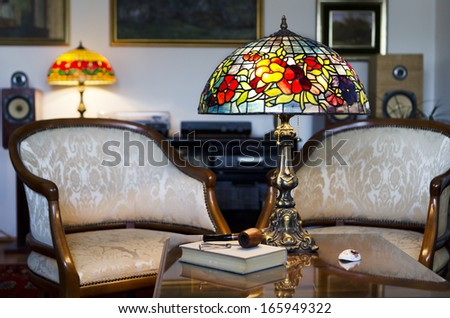 Beautiful hand made lamp on wooden table - stock photo
