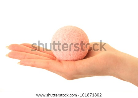 Beautiful hand of the girl with  an aroma bath ball