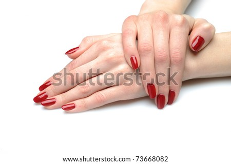 Beautiful hand with perfect nail red manicure isolated on white background - stock photo
