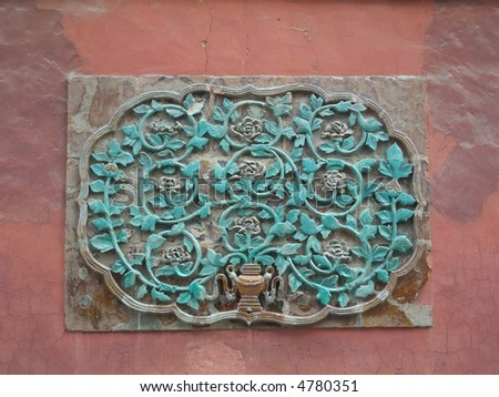 Beautiful handcraft decoration  on red wall - stock photo